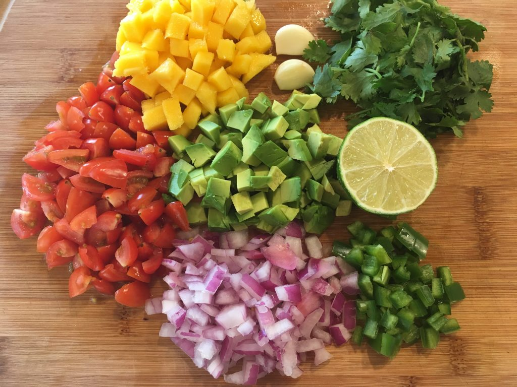 chopped tomatoes, onion, jalapeno, avocado, mango, cilantro, lime
