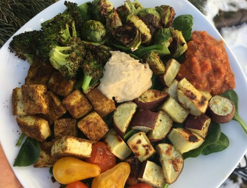 Roasted Sweet Potato, brussel sprouts and broccoli with baked tofu, tomatoes, hummus, and salsa