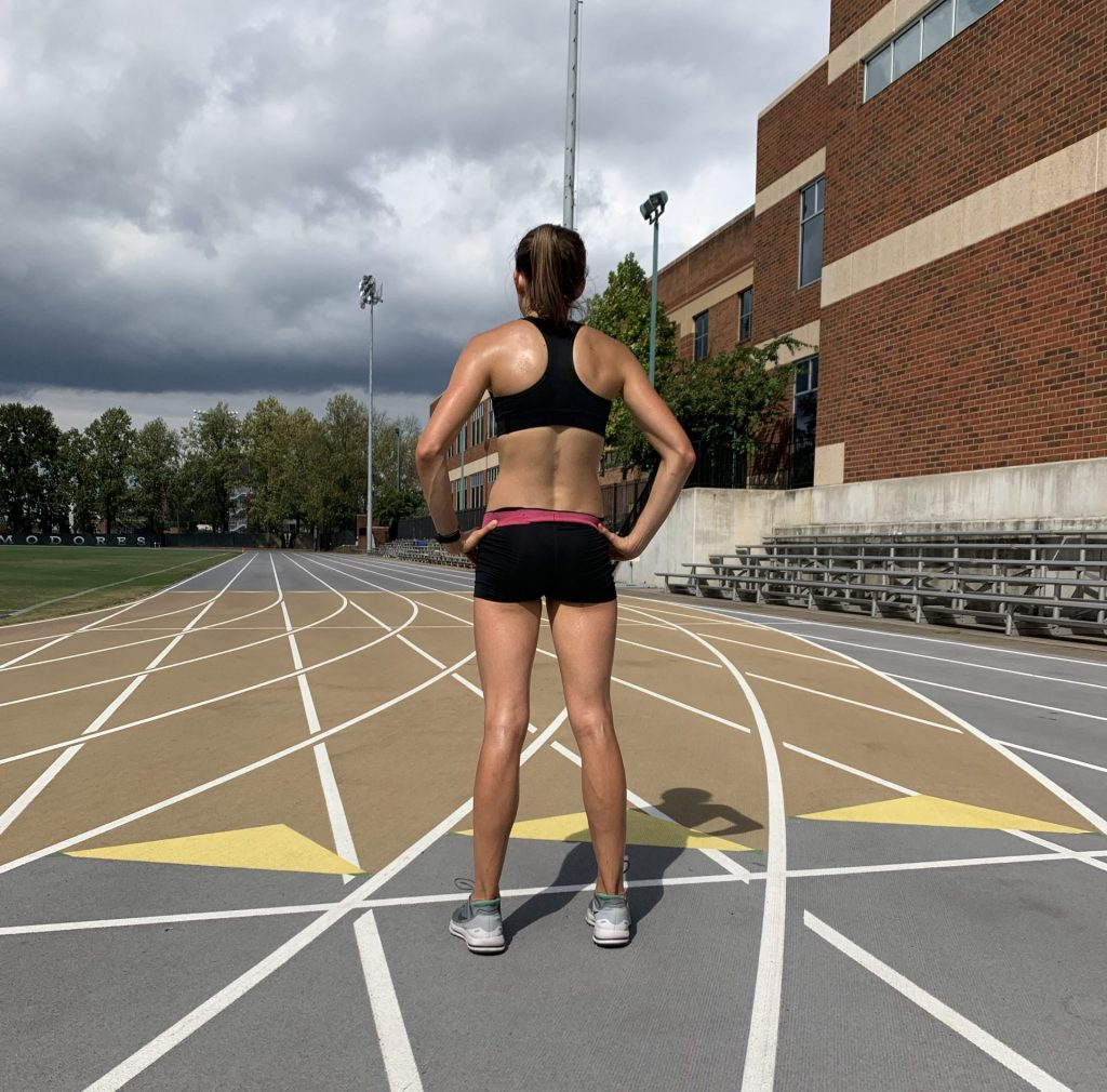 Back of a girl on a track
